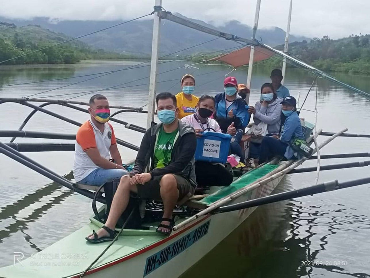 Filipino Barrio Doctors Scale Mountains, Cross Rivers And Seas To Deliver COVID-19 Vaccines