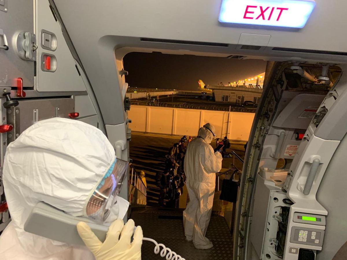 Filipinos are shown on the plane that the Philippine government chartered to fly them out of Wuhan City in China's Hubei province, epicenter of the novel coronavirus contagion. Photos from the Department of Foreign Affairs